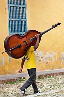 Cuban Culture - Man carrying a bass