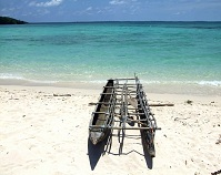 Papua New Guinean Geography - Outrigger canoe on the coast