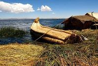 Peruvian Architecture - Reed boat and house on Lake Titicaca