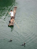 Chinese Culture - Fisherman on the Yulong River